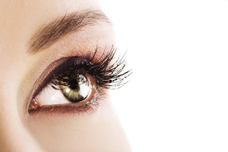Woman Green Eye Closeup. Space For Text.